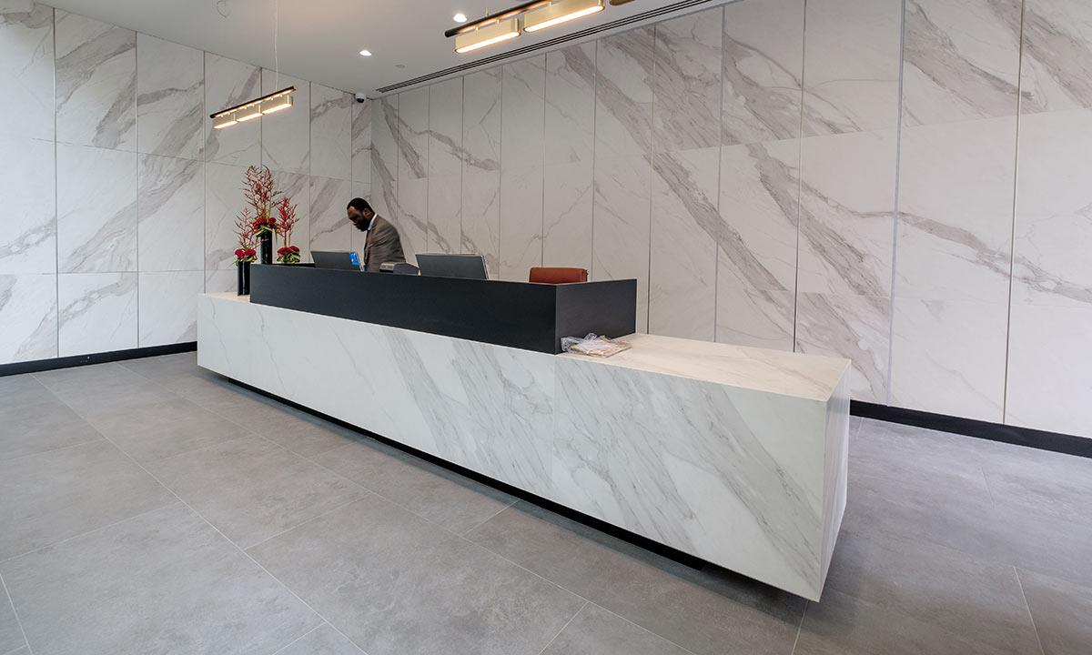 Large bespoke reception desk using marble-effect tiles - Aldwych
